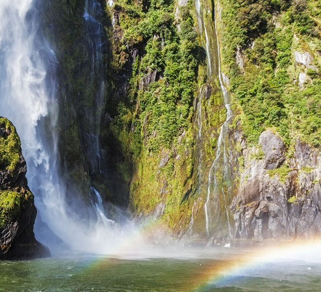Waterfall and rainbow in Milford Sound