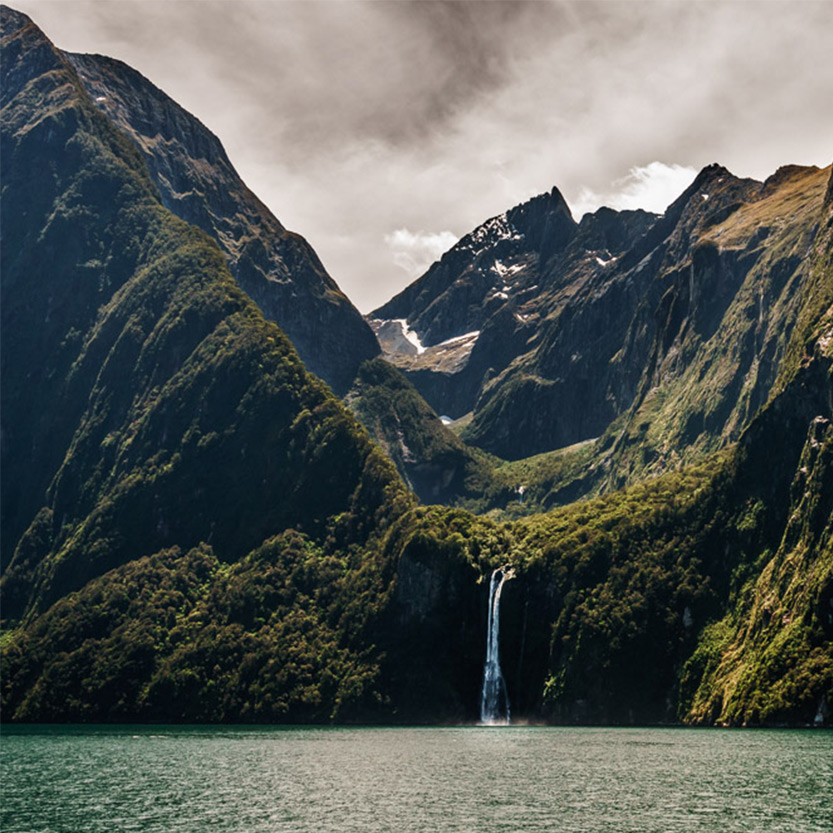 Milford Sound cloudy waterfall